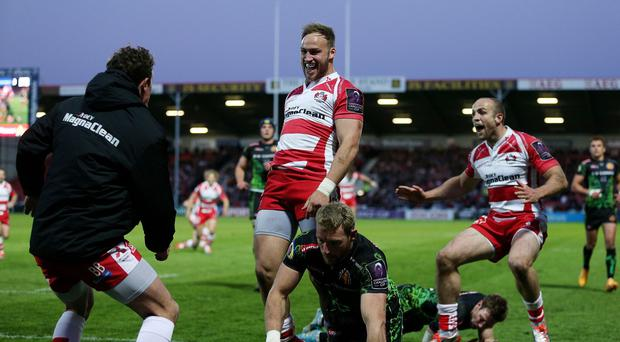 Bill Meakes, centre, scored Gloucester's first try