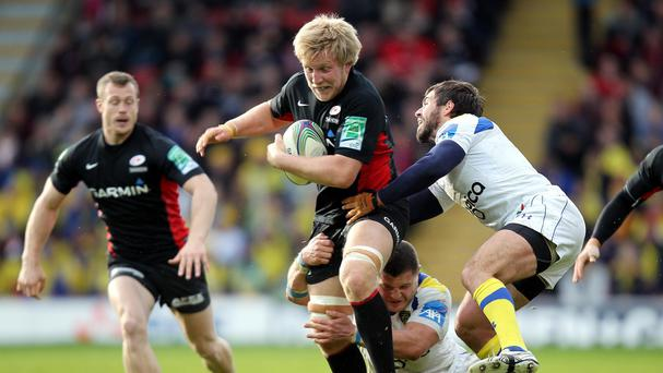 Saracens back-row forward Jackson Wray, pictured centre, has committed his future to the club