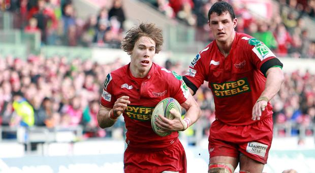 Liam Williams, left, scored one of Scarlets' four tries