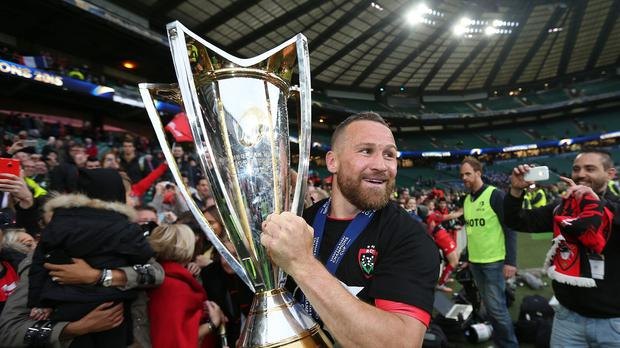 Matt Giteau holds the European Champions Cup trophy after helping Toulon beat Clermont Auvergne at Twickenham