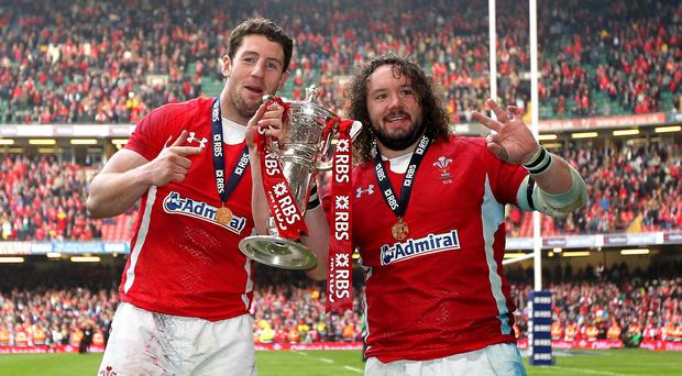 Alex Cuthbert, left, and Adam Jones, right, celebrate Wales winning the Six Nations Grand Slam in 2012.