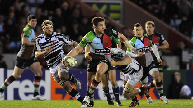 Harlequins centre Tom Casson, pictured centre, has agreed a two-year deal with Championship club Yorkshire Carnegie