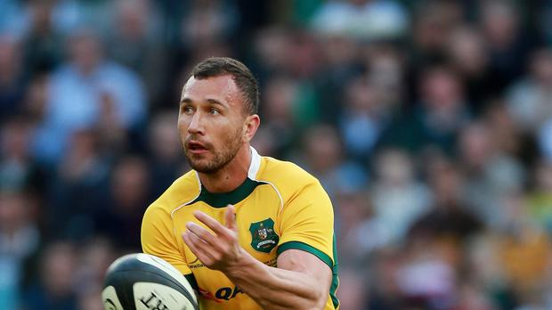 Quade Cooper, pictured, scored a brace along with Reds team-mate Lachie Turner