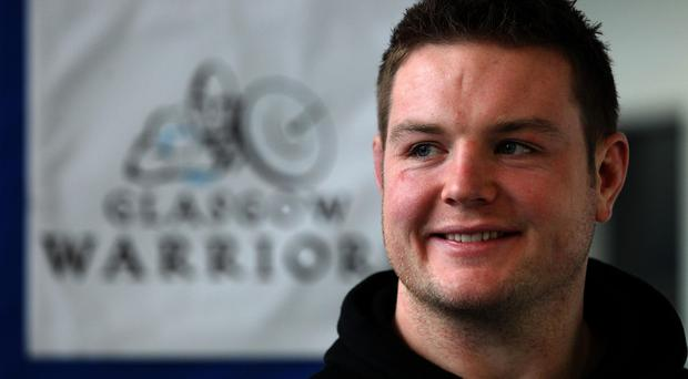 Departing Glasgow Warriors prop Jon Welsh signs off with a Guinness Pro12 winner's medal
