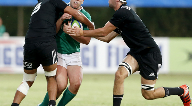 Stop there: Ireland's Sean McNulty is tackled by Akira Ioane in the Under-20 clash INPHO