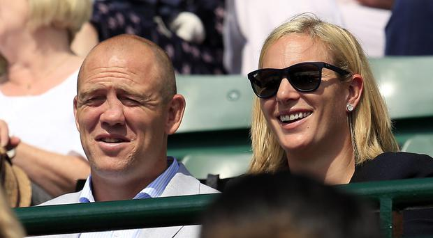 Zara Phillips and Mike Tindall watch the action on court number 1 during day Nine of the Wimbledon Championships at the All England Lawn Tennis and Croquet Club, Wimbledon.