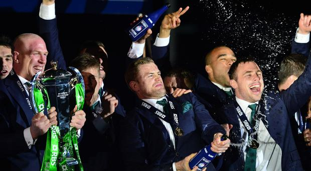 Ireland captain Paul O'Connell (left), as Jamie Heaslip sprays his team with champagne as Ireland win the Six Nations.