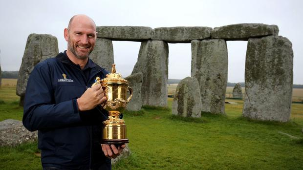 Lawrence Dallaglio shows off the Webb Ellis Cup at Stonehenge
