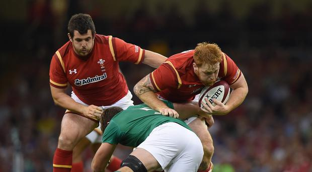 Wales' Dan Baker (right) is tackled by Ireland's Donnacha Ryan during the World Cup Warm Up match at the Millennium Stadium, Cardiff.