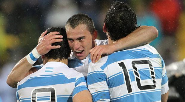 Juan Imhoff, centre, led Argentina to a famous win
