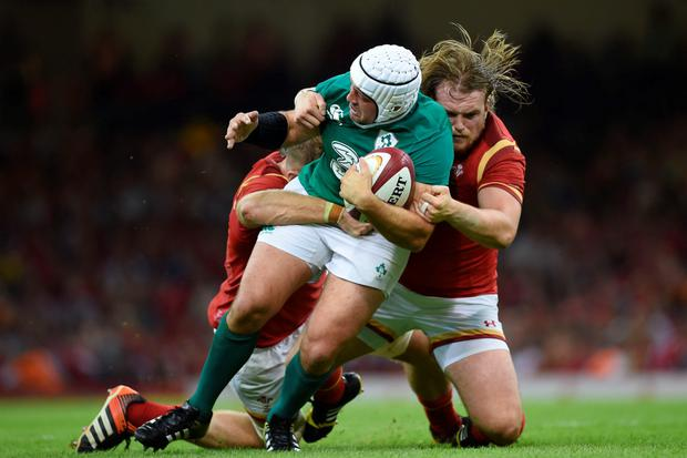 Crunch moment: Ireland's Rory Best is tackled by Dominic Day (left) and Kristian Dacey (right) of Wales