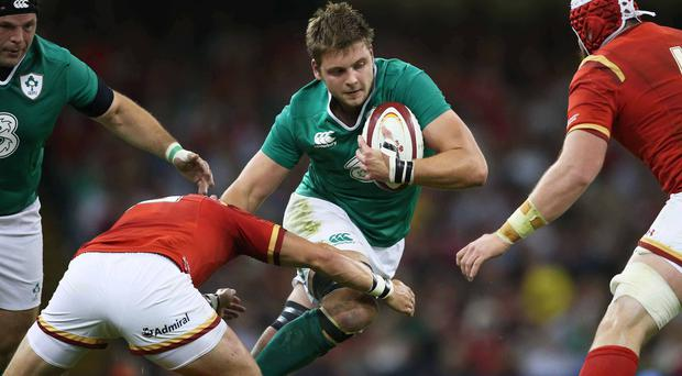Making his mark: Iain Henderson takes on Wales in the World Cup warm-up match at the Millennium Stadium