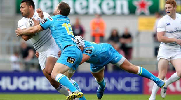 Crunch time: Darren Cave tries to break free of some tough Leinster tackling