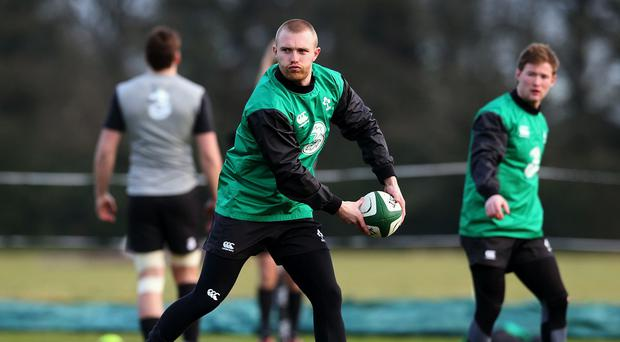Munster back Keith Earls was carried off injured during Ireland's World Cup warm-up match against Wales