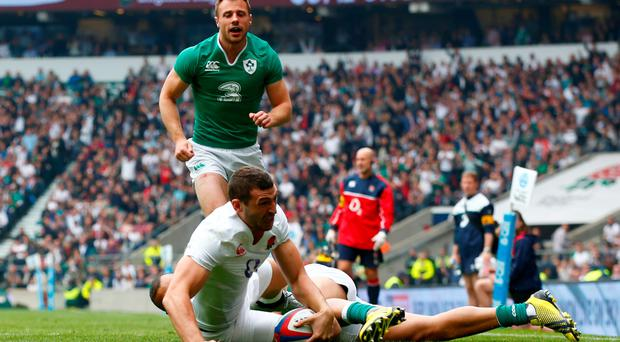 Trying afternoon: Tommy Bowe looks on as Jonny May scores for England at Twickenham