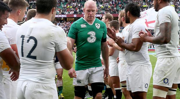 Nightmare farewell: Paul O'Connell is applauded off the Aviva Stadium pitch by victorious England players on his last appearance for Ireland in Dublin