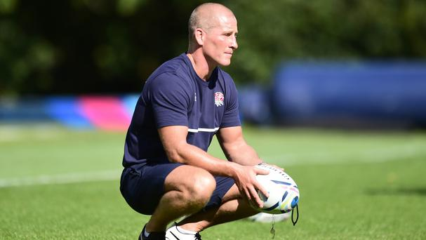 England head coach Stuart Lancaster oversees training at the squad's Surrey base