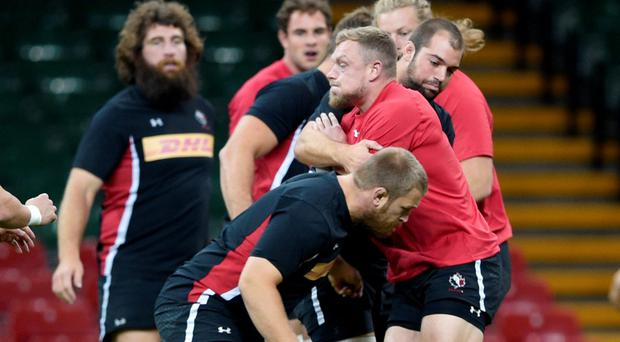 Getting to grips: Canada players train at the Millennium Stadium ahead of the World Cup clash with Ireland