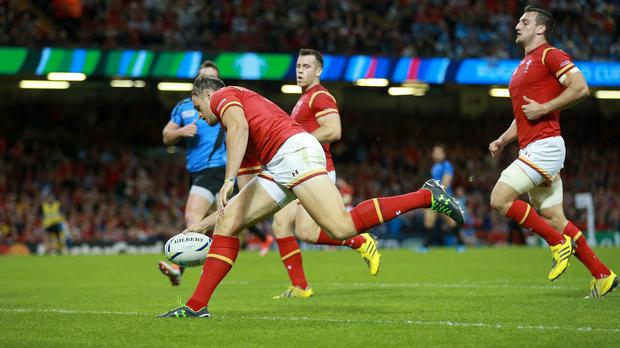 Wales' Cory Allen scores his side's fourth try against Uruguay, but was later injured