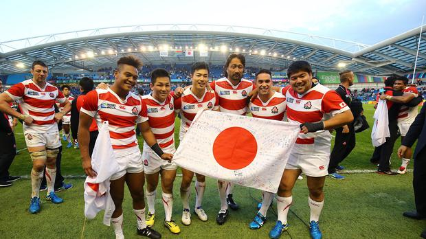 Japan players celebrate their stunning World Cup victory over South Africa in Brighton