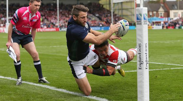 Scotland's Tommy Seymour is tackled by Japan's Ayumu Goromaru just before the try line