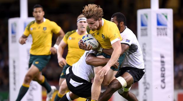 Michael Hooper, centre, says Australia have kept something back for World Cup tests against England and Wales