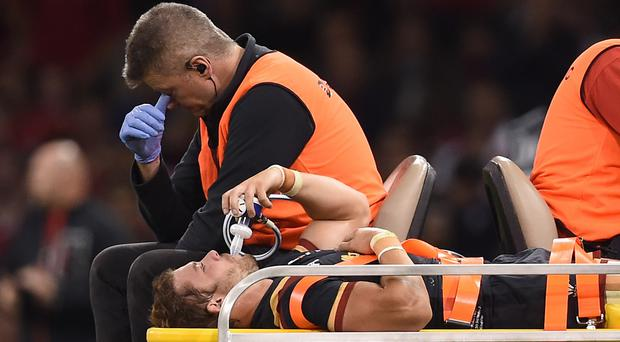 Leigh Halfpenny leaves the Millennium Stadium pitch after suffering a serious knee injury against Italy three weeks ago