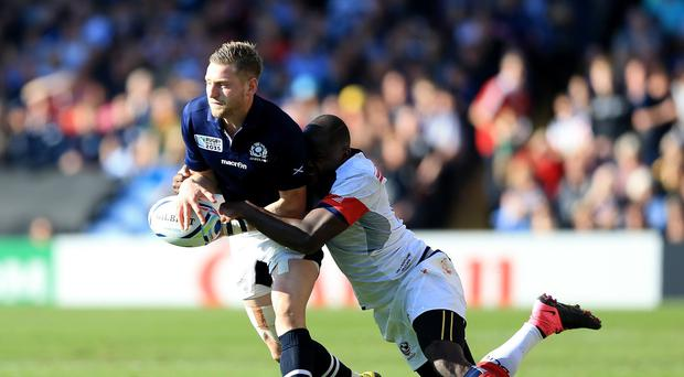 Scotland's Finn Russell will have an ankle injury assessed on Monday