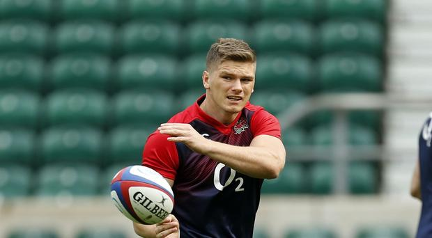 Owen Farrell, pictured, believes England will fight for Stuart Lancaster in Saturday's crucial World Cup battle with Australia