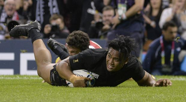 Julian Savea, front, scores his third try against Georgia