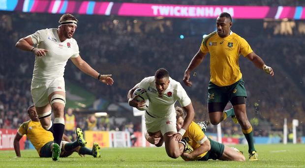 Anthony Watson, centre, scored a try for England, but the hosts exited the World Cup