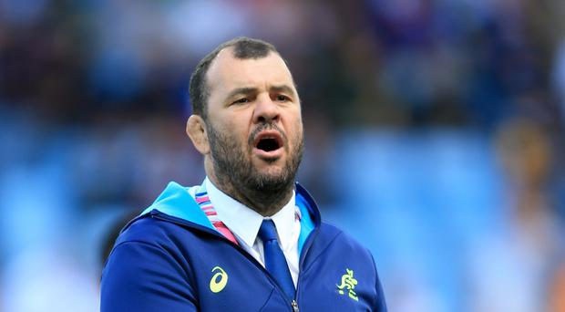 Michael Cheika, pictured, scares his Wallabies squad witless, according to Ireland fly-half Johnny Sexton