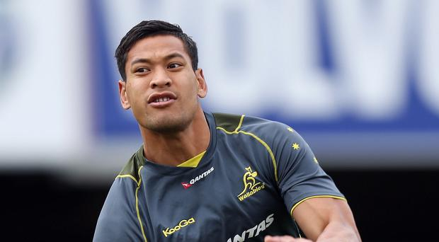 Full-back Israel Folau is battling to be fit for Australia's World Cup clash against Wales at Twickenham on Saturday