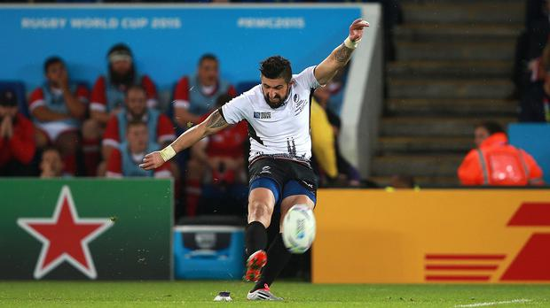 Romania's Florin Vlaicu kicks to win the match against Canada