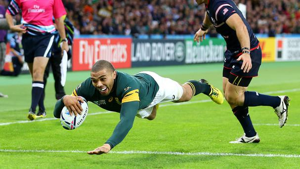 South Africa's Bryan Habana dives in to bring up his hat-trick