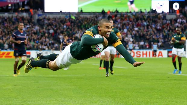 South Africa's Bryan Habana takes flight to plunder another World Cup try