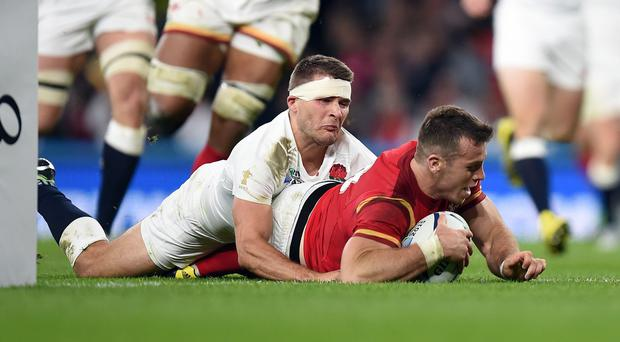 Wales scrum-half Gareth Davies, pictured, has been praised by Australia's Will Genia