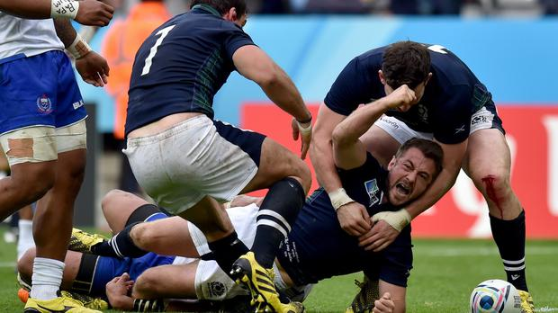 Scotland's Greig Laidlaw celebrates scoring their third try against Samoa