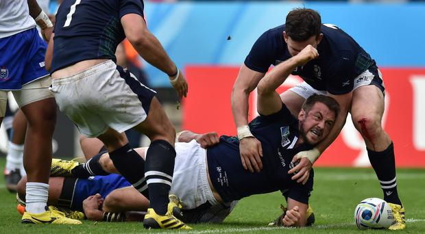 Emotions ran high for Greig Laidlaw, second right, and Scotland but he hailed his coach for calming the team down