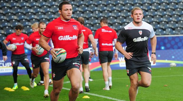 Tom Burgess, right, says brother Sam, left, has no regrets over his switch to rugby union