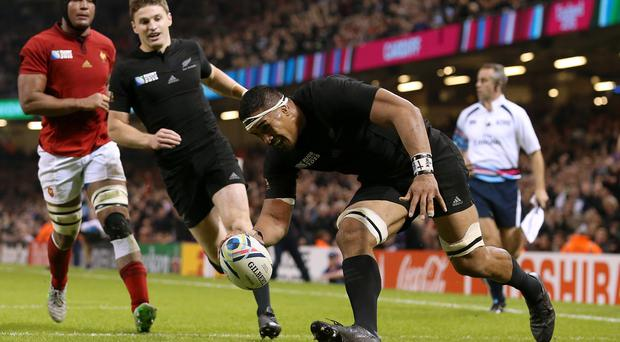 New Zealand's Jerome Kaino (right) scores their fifth try against France.