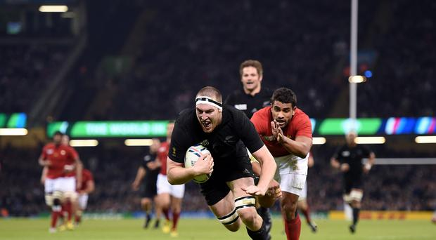 Brodie Retallick, centre, scores New Zealand's first try in the 62-13 demolition of France