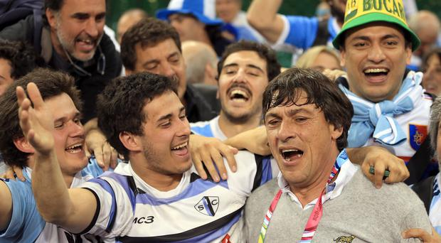 Argentina coach Daniel Hourcade celebrates with fans following their 43-20 World Cup quarter-final victory over Ireland.