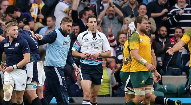 Referee Craig Joubert, pictured in white, awarded a controversial late penalty against Scotland at Twickenham