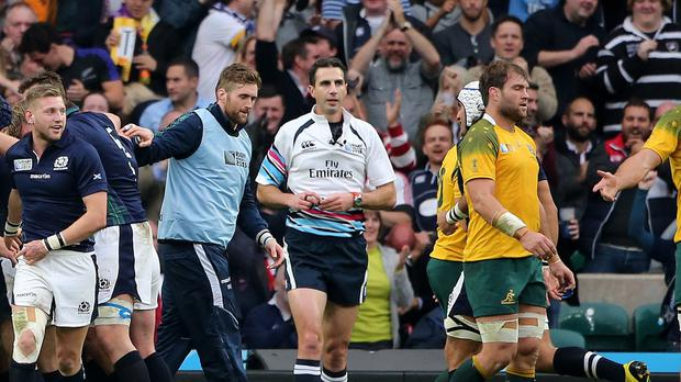 Craig Joubert, pictured centre, made the crucial late call at Twickenham