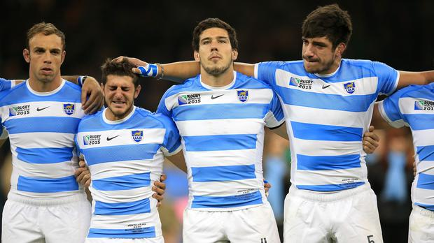 Tomas Cubelli, second left, cries during the national anthem before Argentina's World Cup quarter-final with Ireland