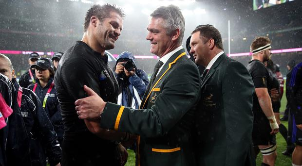 South Africa coach Heyneke Meyer, right, congratulates Richie McCaw after New Zealand's semi-final victory