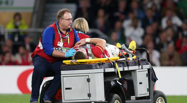Wales centre Scott Williams is taken away injured during the World Cup pool game against England. His exit was one of several setbacks Wales suffered