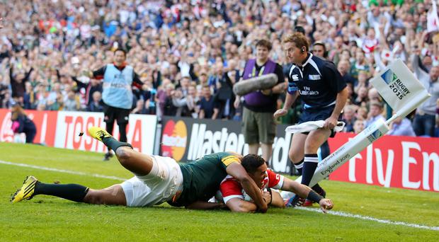 Karne Hesketh dives over to score a winning try deep into injury time as Japan stunned World Cup opponents South Africa in Brighton