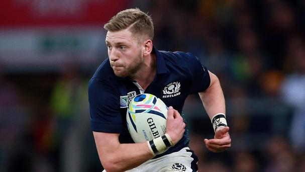 Scotland's Finn Russell has committed himself to Glasgow